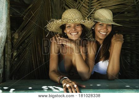 Hispanic women wearing straw hats
