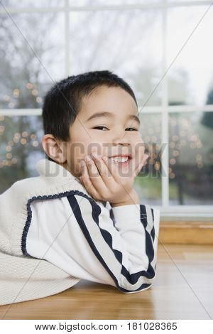 Mixed Race boy in front of window
