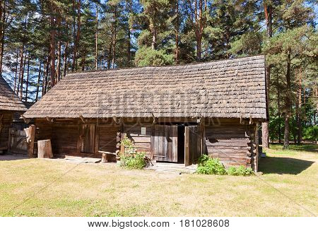 RIGA LATVIA - JUNE 13 2016: Cart shed with storehouse for fish (circa 1840) of Delini fishermen farmstead of Kurzeme ethnic group. Exhibited in Ethnographic Open-Air Museum of Latvia since 1971