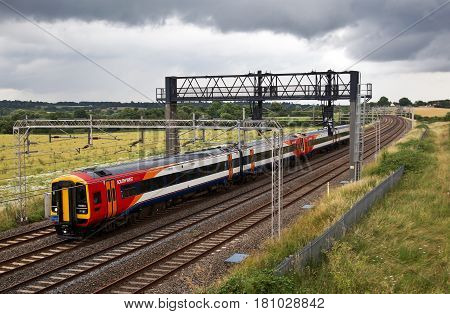 SOULBURY, UK - JULY 12 : A South West railways operated class 158 DMU heads towards Wolverton depot for refurbishment & overhaul on July 12, 2016 in Soulbury