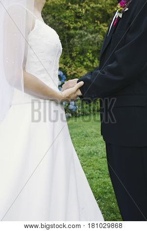 Asian newlyweds holding hands