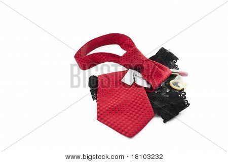 Tie, Panties, Lipstick And Condom