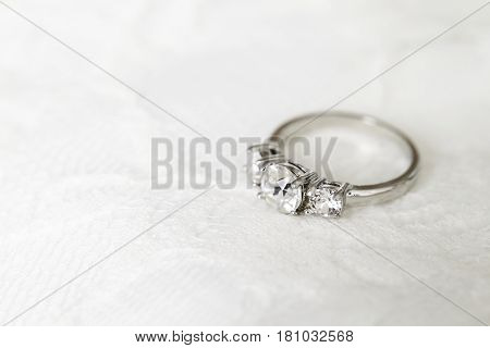 Diamond wedding ring on white close up