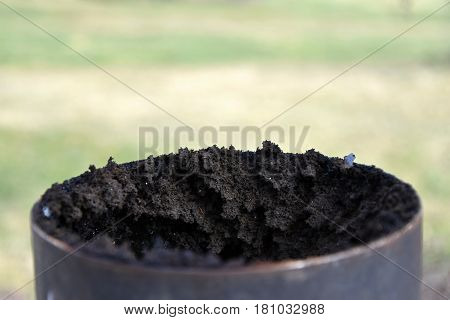 Chimney flue pipe covered with a thick layer of soot.