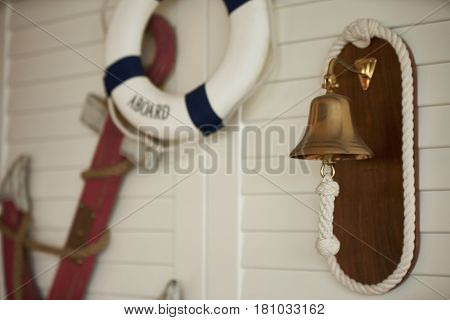 Composition on the marine theme with anchor paddle and lifeline on old wooden background