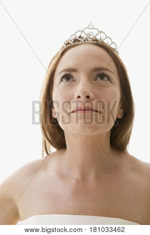 Hispanic woman wearing tiara