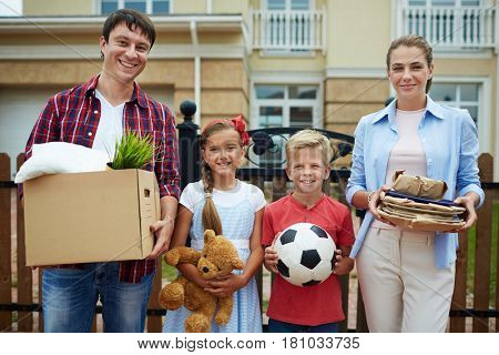 Happy family of four going to move to bigger house