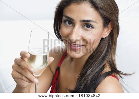 Middle Eastern woman toasting with champagne