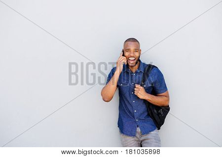 Young African Man Laughing With Mobile Phone