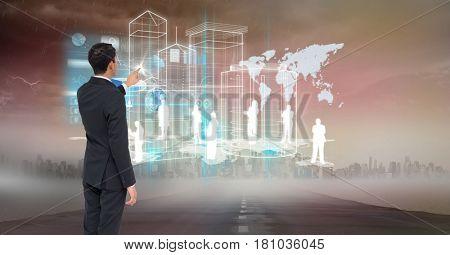 Digital composite of Digital composite image of businessman touching huge screen