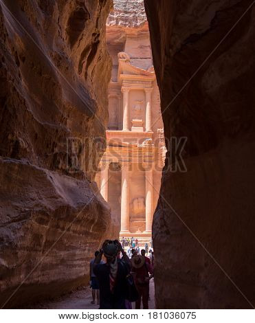 Tourists travellers visiting Petra in Jordan during summer vacation