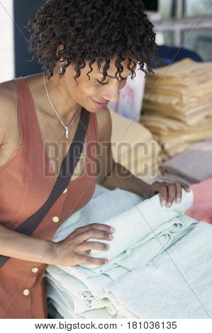 African woman shopping for towels