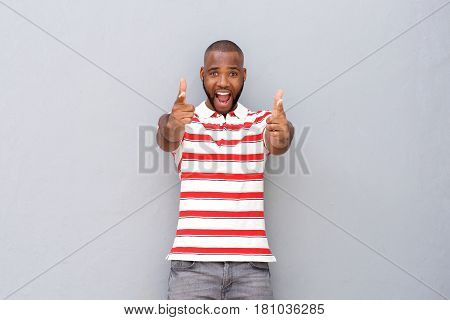 Excited Young African Man Pointing
