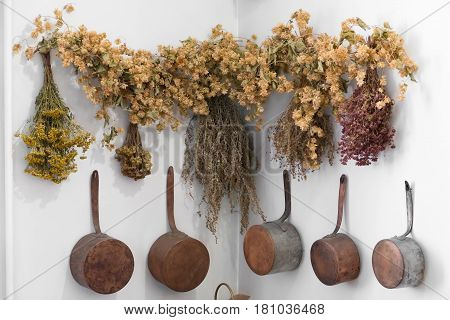 Grodno, Belarus - April 5, 2017: Apothecary Healing Herbs Bunches And Vintage Kitchen Equipment In T