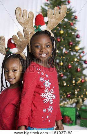African sisters wearing reindeer antlers