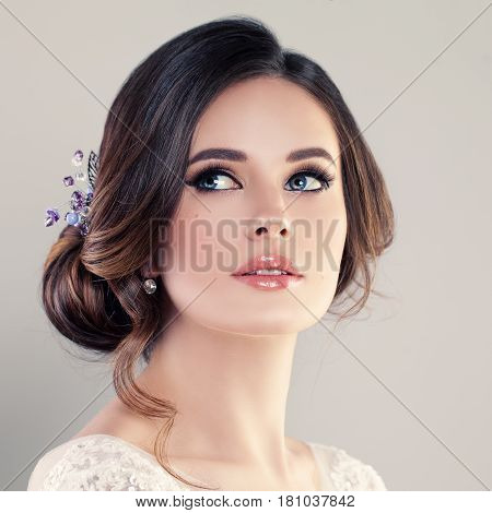 Beautiful Bride with Makeup and Bridal Hairstyle. Pretty Woman Fiancee Looking Up Face Closeup
