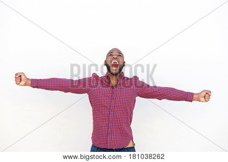 Excited Young African Man With Arms Outstretched Shouting