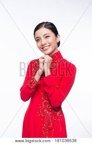 Charming Vietnamese Woman In Ao Dai Traditional Dress, Gesture To Pray Or Wishing.