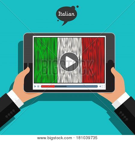 Concept of learning languages. Study Italian. Hand drawn Italian flag on the tablet screen. Film in Italian.