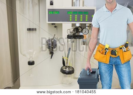 Digital composite of Midsection of carpenter standing in workshop