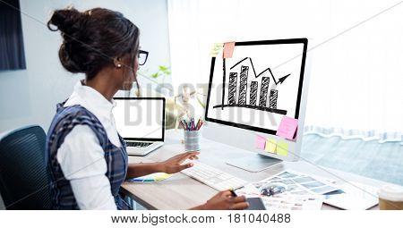 Digital composite of Businesswoman analyzing graph on desktop computer