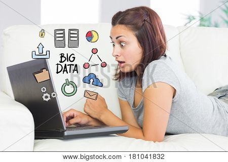 Digital composite of Digitally generated image of surprised woman using laptop with big data diagram at home