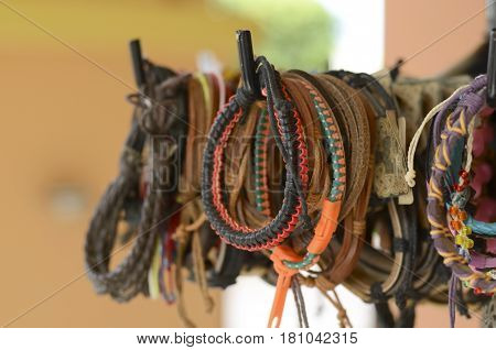 Leather bangles on display at local souvenir store. Vacation travel background