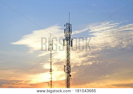 Mobile phone communication tower transmission  signal  leash on the evening