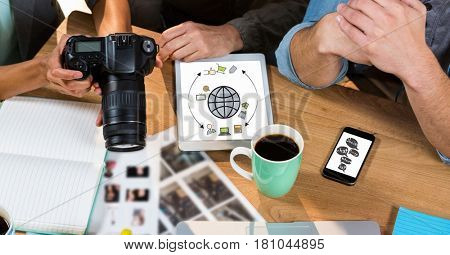 Digital composite of High angle view of business people with camera discussing at table in office