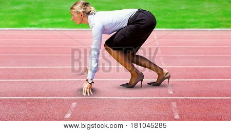 Digital composite of Digitally generated image of Businesswoman on starting point at racing track