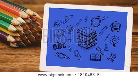 Digital composite of High angle view of various icons in digital tablet by color pencils at table