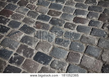 Close Up Picture Of Old Cobblestone Street.
