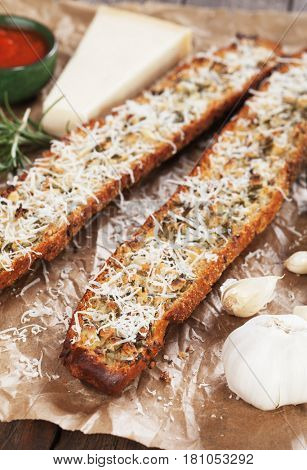 Toasted garlic bread with rosemary and parmesan cheese