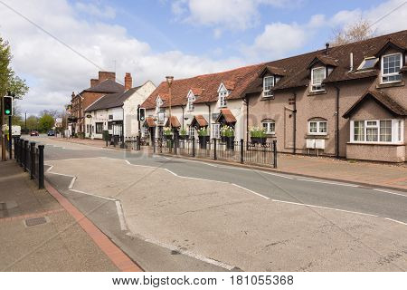 Chirk Wales UK - April 6 2017: The Welsh town of Chirk or Y Waun (in Welsh) on the border of Wales and England with it's rows of small shops and cottages