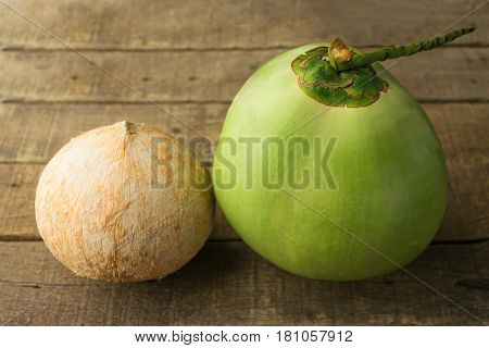 coconut on table wood vintage background in close up