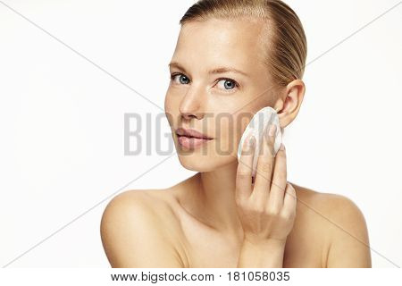 Body care beauty using cotton pad portrait
