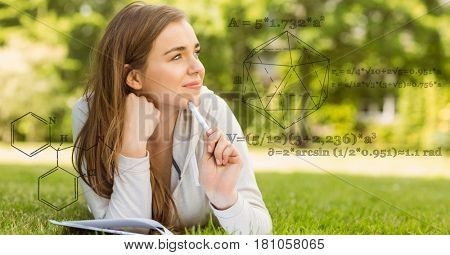 Digital composite of Digitally generated image of various structure with woman studying on field in background