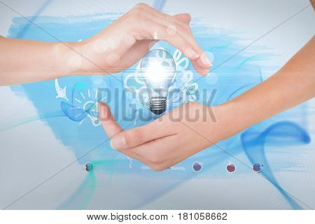 Digital composite of Digitally generated image of hand holding electric bulb