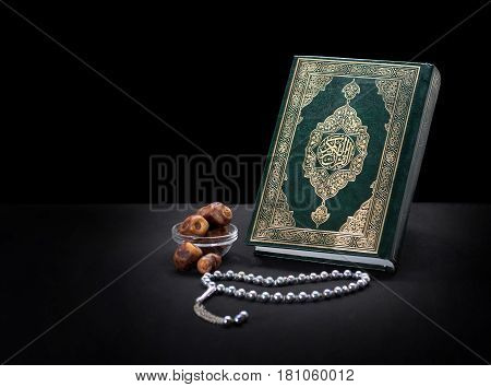 Holy Book Of Quran With Rosary And Dates