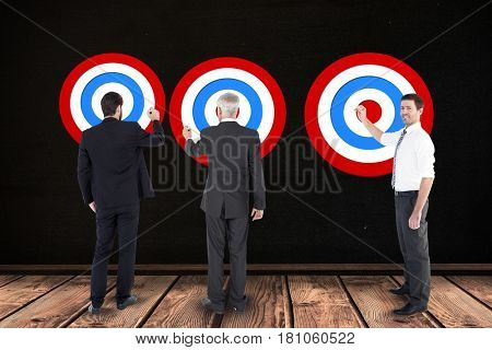 Digital composite of Digital composite image of business people setting targets
