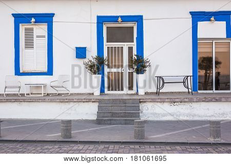 A front entrance of a home with a door.