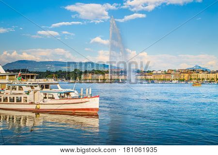 Historic City Of Geneva With Famous Jet D'eau Fountain And Ships At Sunset, Switzerland