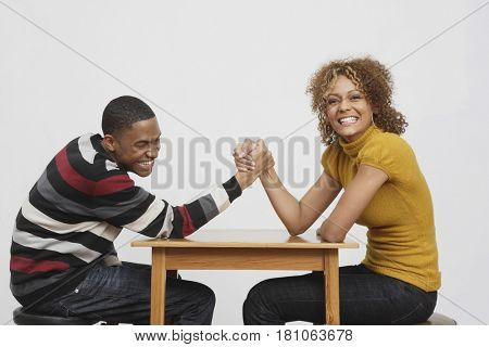 African couple arm wrestling