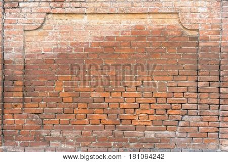 Red brick wall with bricks in shape of portal
