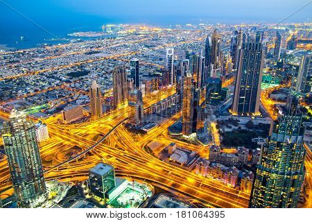 Top view of a highway junction and the coast in Dubai UAE at sunrise. Sheikh Zayed road in Dubai downtown.