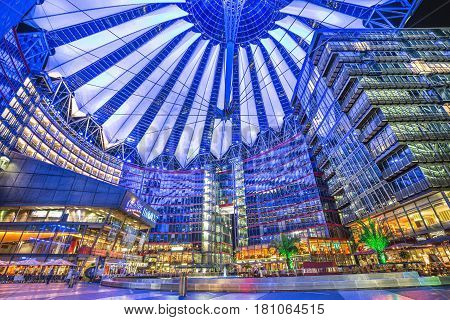 Famous Sony Center at Potsdamer Platz illuminated at night in Berlin Germany. The modern complex houses shops restaurants as well as Sony's European headquarters.