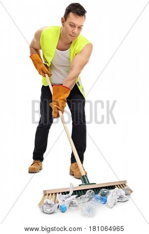 Full length portrait of a waste collector cleaning with a broom isolated on white background
