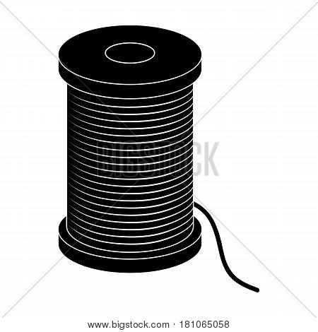 A reel of blue thread.Sewing or tailoring tools kit single icon in black style vector symbol stock web illustration.