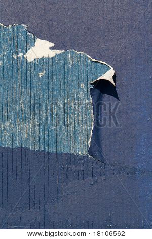 Peeling paper on wall