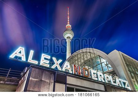 Alexanderplatz Neon Sign With Tv Tower And Train Station At Night, Berlin, Germany